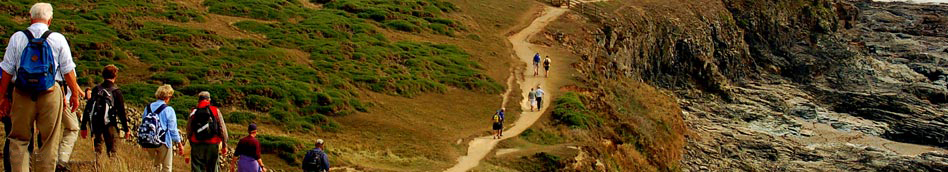 Footpath Holidays walkers on s hilly section of the Cornwall Coast Path near Pentire